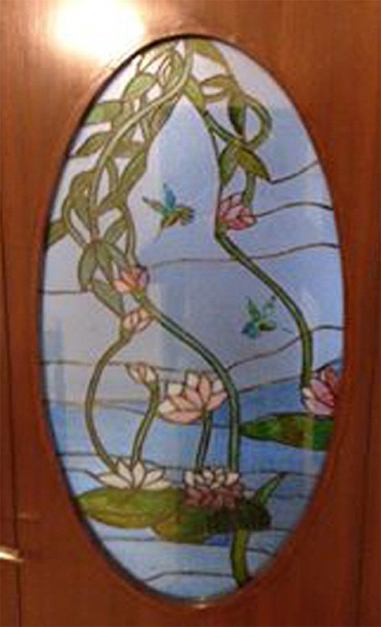 Stained Glass Oval decal inset in a Teak door